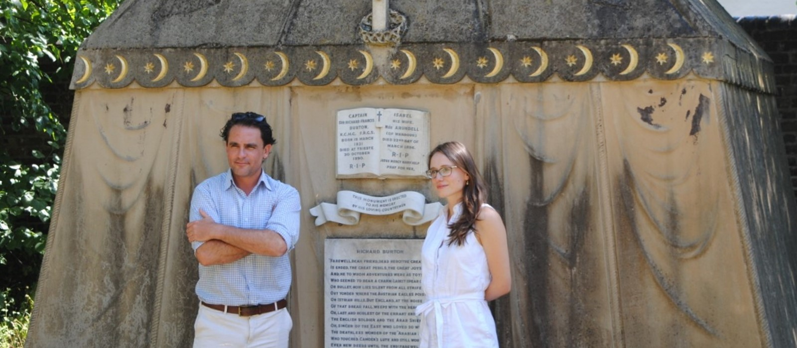 Levison Wood and Emily Lunn standing infant of a mausoleum