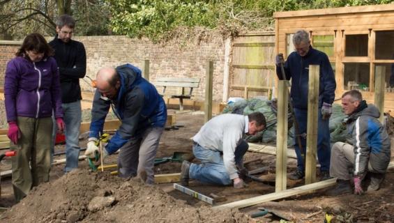 Team constructing timber frame